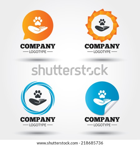Shelter pets sign icon. Hand holds paw symbol. Animal protection. Business abstract circle logos. Icon in speech bubble, wreath. Vector - stock vector