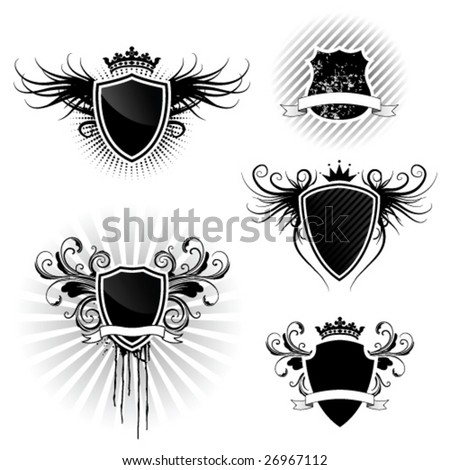 Shield designs set - stock vector