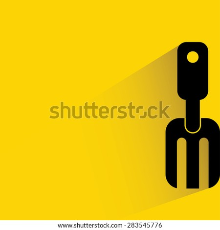shovel in yellow background, flat and shadow theme
