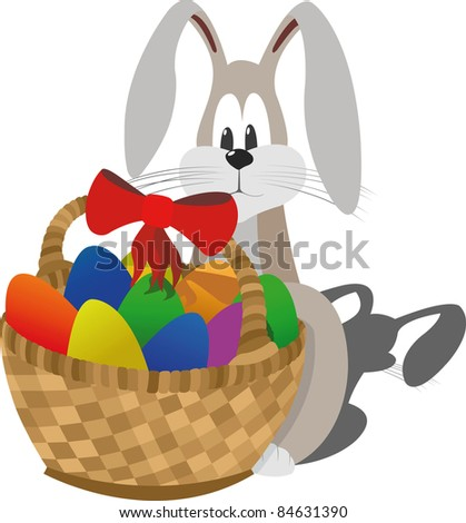 Shy easter rabbit sits near the basket with colorfull eggs