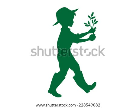 Silhouette of a boy gardener carrying a plant