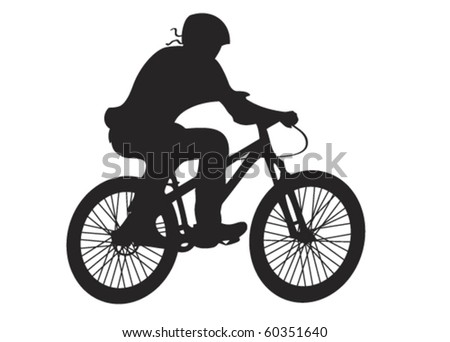Silhouette of a man on bicycle