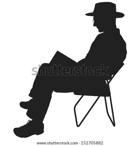 Silhouette of a man reading. He is sitting in a chair and wearing a hat and glasses - stock vector