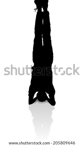 silhouette of a man standing on his head  yoga pose