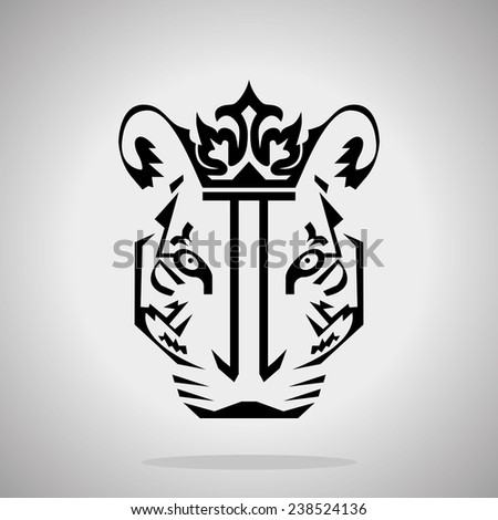 Silhouette of a tiger with a crown on a gray background