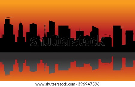 Silhouette of city with orange background