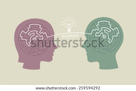 silhouette of heads with a labyrinth inside over beige background