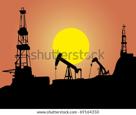 Silhouette of oil workings out on an orange background