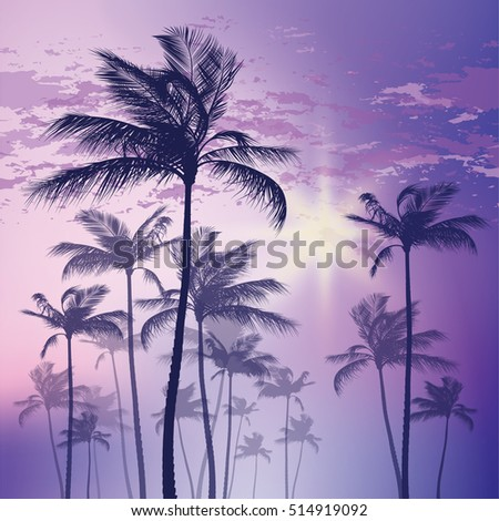 Silhouette of palm tree and sunset sky