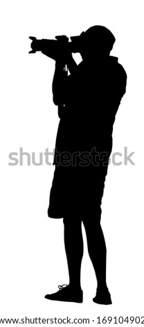 Silhouette of Photographer Standing with Camera in Hand