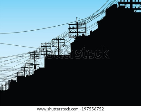 Silhouette of poles and wires on College Street in Toronto, Ontario, Canada