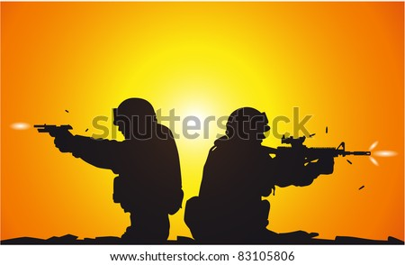 Silhouette of shooting soldiers