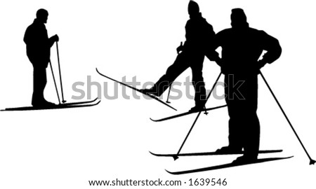 Silhouettes of three cross country skiers