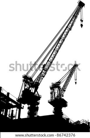 Silhouettes of two cranes on building - stock vector