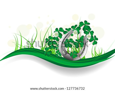 Silver horseshoe with clover leaves and ribbons