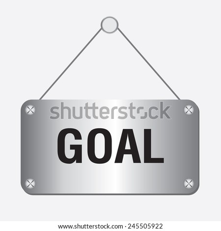silver metallic goal sign hanging on the wall