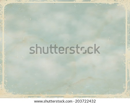 Sky background with spots, grunge frame and a place for text. Retro style. Vector illustration.  - stock vector