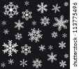 Snowflakes on a black background. Christmas seamless background. - stock vector