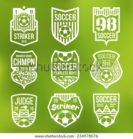 Soccer emblems in flat style. White print on a blurred background - stock vector