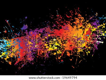 Spray of multi coloured ink on a black background