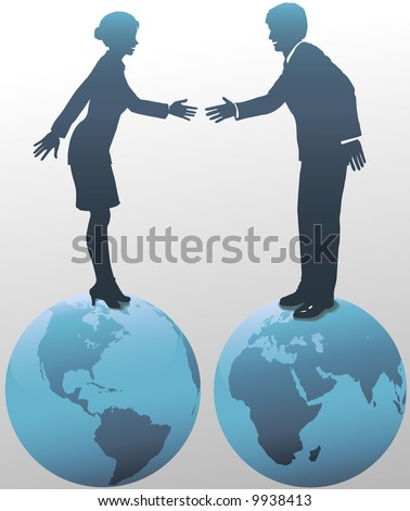 Standing on top of the world, East meets West as global business people, man and woman, shake hands in agreement.