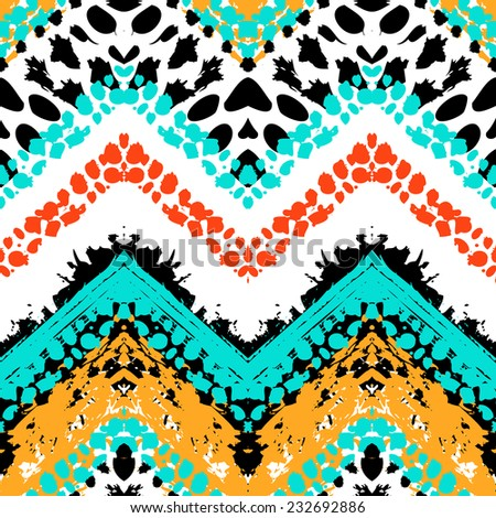 Striped hand painted vector seamless pattern with ethnic and tribal motifs, zigzag lines, brushstrokes and splatters of paint in multiple bright colors for summer fall fashion - stock vector