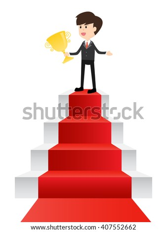 successful businessman celebrates with trophy in his hands on top staircase with red carpet to success