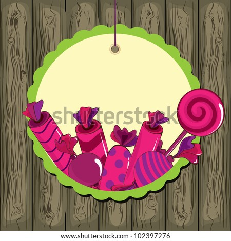 Sweets on strings with frame on the wooden background - stock vector