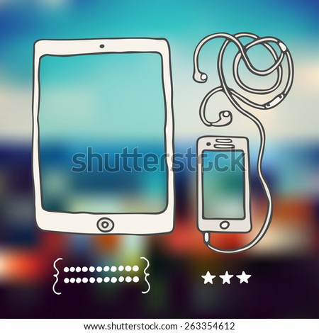 Tablet and phone on blurred background.