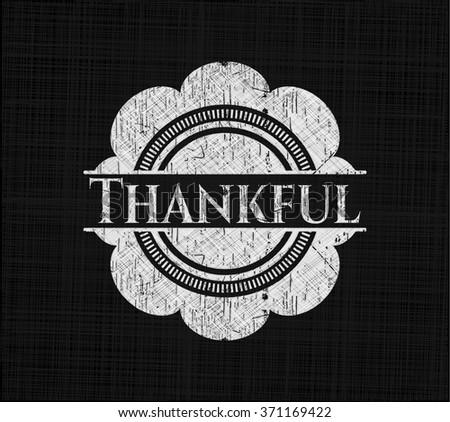 Thankful written on a chalkboard - stock vector