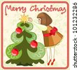 The little girl decorates the Christmas tree - stock