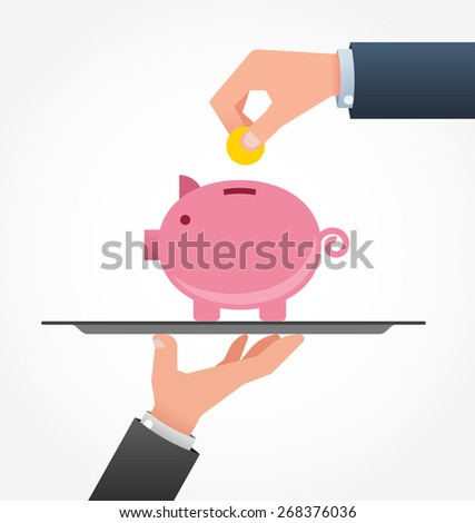 The man adds a coin in a piggy Bank on a tray