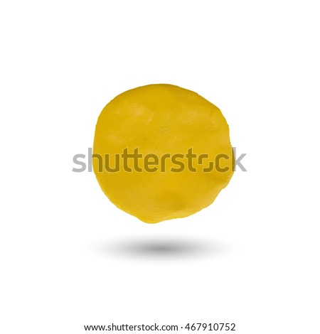 the piece of yellow clay.round yellow spot