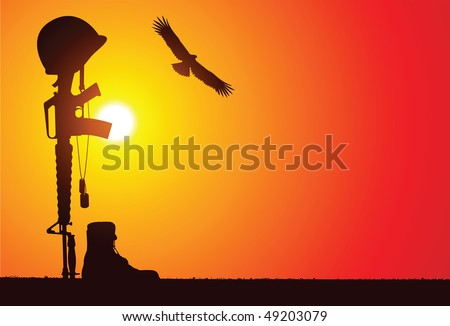The soldier's rifle with bayonet attached stuck into the ground, helmet on top, dog tags on the rifle and the boots of the fallen soldier