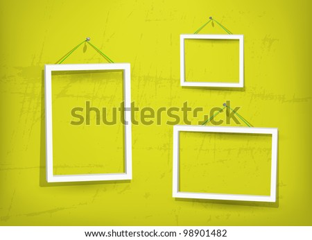Three empty frame of picture on the yellow old wall. Eps10. Used opacity layers for effect of shadows - stock vector