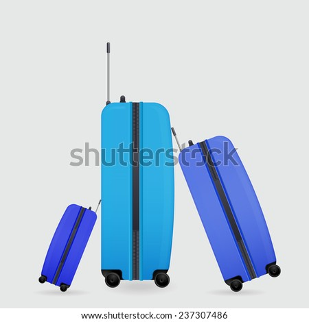 three modern suitcases on wheels ready to travel - stock vector