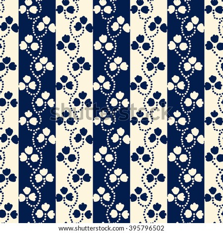 Traditional block printed ornament. Seamless floral pattern, handmade Russian folk motif with clover on stripped background in blue and ecru. Textile print. - stock vector