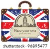 Travel suitcase with flag of Britain and Big Ben - stock photo