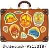 Travel suitcase with stickers of different cities - stock photo