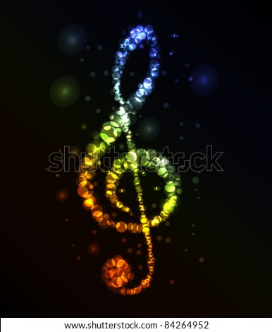 Treble clef in dark made from color lights