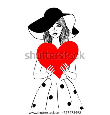 Trendy girl, holding red heart in hands.