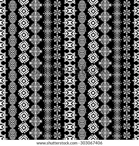 Tribal art boho seamless pattern. Ethnic geometric print. Repeating border background texture in black and white. Fabric, cloth design, wallpaper, wrapping
