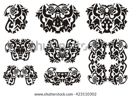 Tribal bird symbols from butterfly wing. Owls and parrots, the frame from parrots formed by a peaked wing of a butterfly, isolated on a white background - stock vector