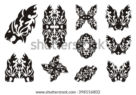 Tribal flaming lion head symbols and elements from it. The stylized lion head, a lion butterfly, a frame and the decorative twirled lion symbols - stock vector