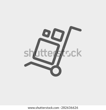 Trolley with boxes icon thin line for web and mobile, modern minimalistic flat design. Vector dark grey icon on light grey background. - stock vector