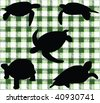 Turtle silhouette on a green background - stock photo
