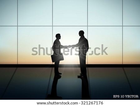 Two Businessman shaking hand silhouettes