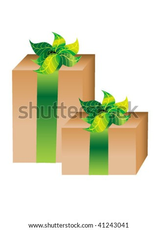 Two cardboard giftboxes with green ribbon and leaves for bows