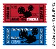 Two colorful cinema tickets in red and blue with movie projector shape - stock photo