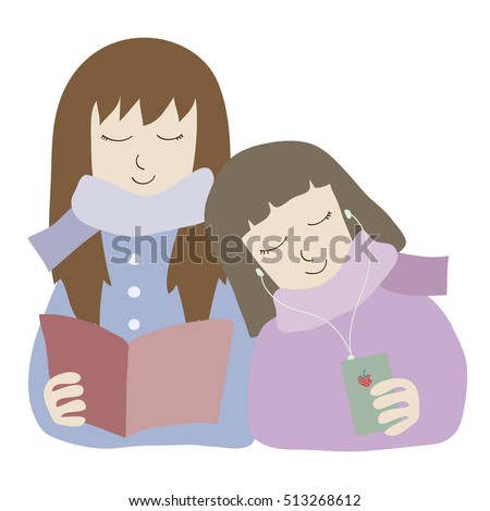 two girls relaxed reading and listening to musics / lesbian couple in winter costume sit together